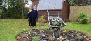 Gardening club show off their wheelbarrow masterpiece