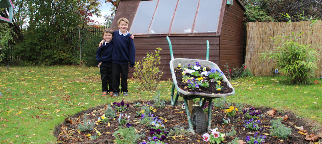 Gardening club show off their wheelbarrow masterpiece