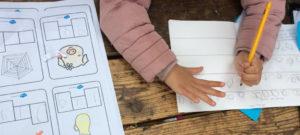 Nursery practise their handwriting